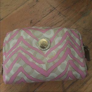 Pink coach zebra makeup bag!